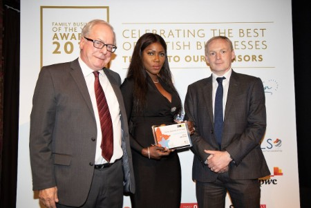 Douglas Anderson and his wife Khadija Anderson are pictured collecting the award from Mike Kennedy, Director of Western Pension Solutions, who sponsored the category